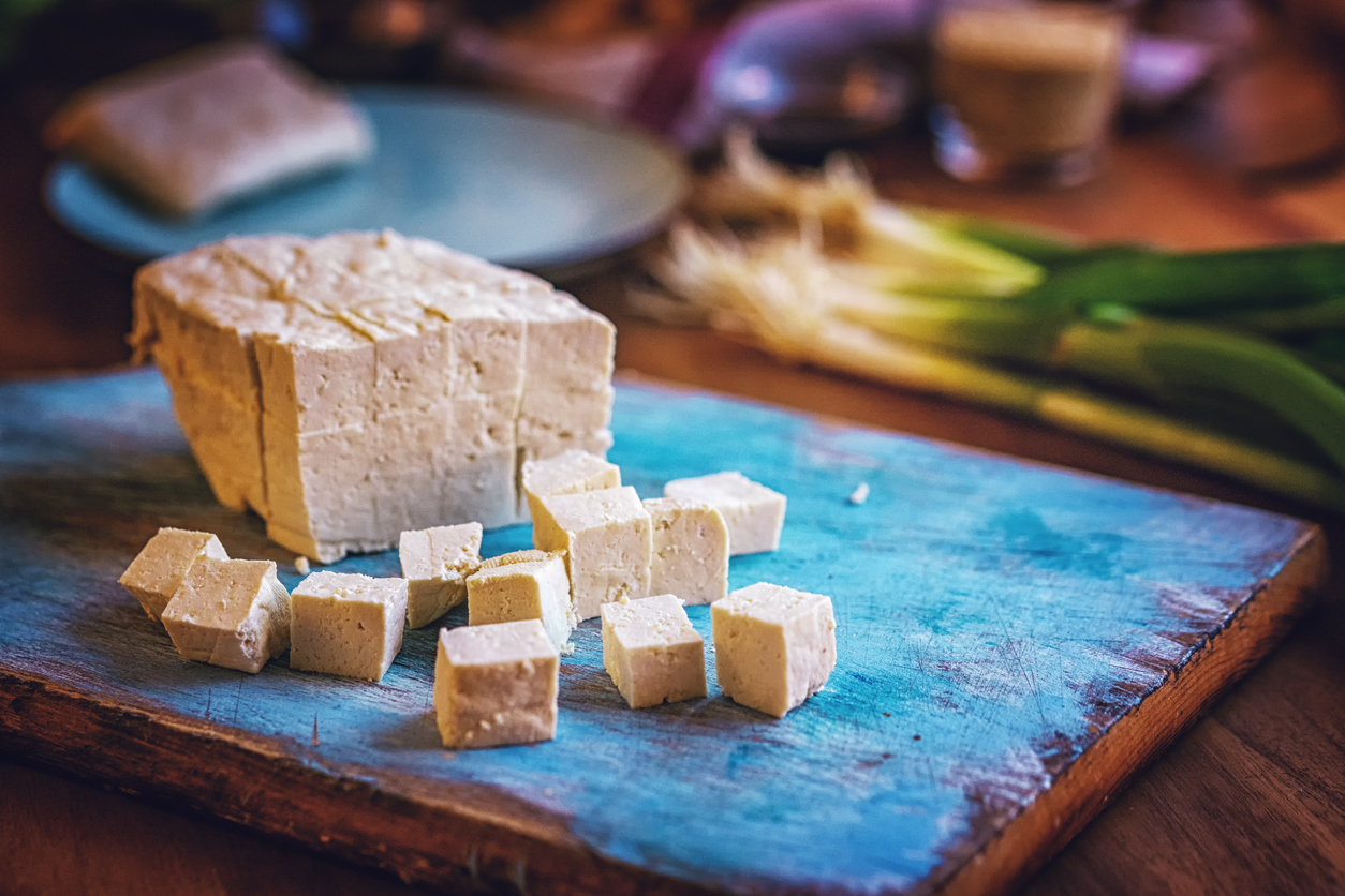 fresh-tofu-and-spring-onions-on-cutting-board