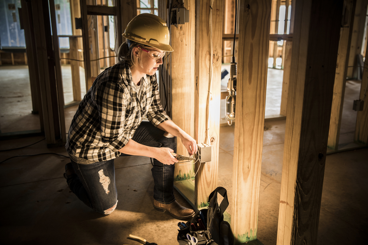 Electrician working at a home construction site