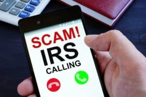 A smartphone screen showing a scam IRS call in progress