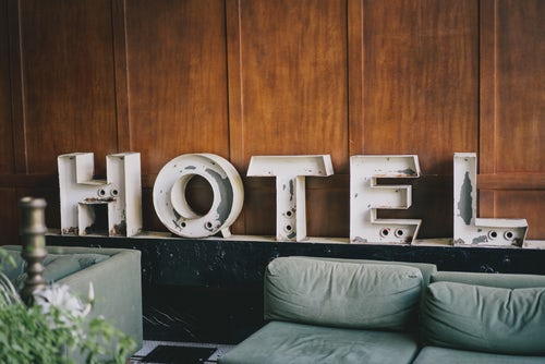 hotel-sign-behind-sofas