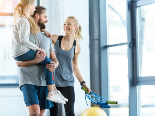busy mom makes time for fitness with happy family at gym