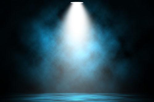 spotlight-coming-down-from-above-to-highlight-writer-spotlight