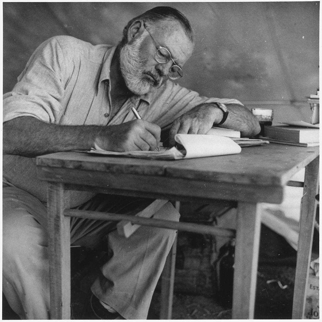 old-man-writing-black-and-white-photograph