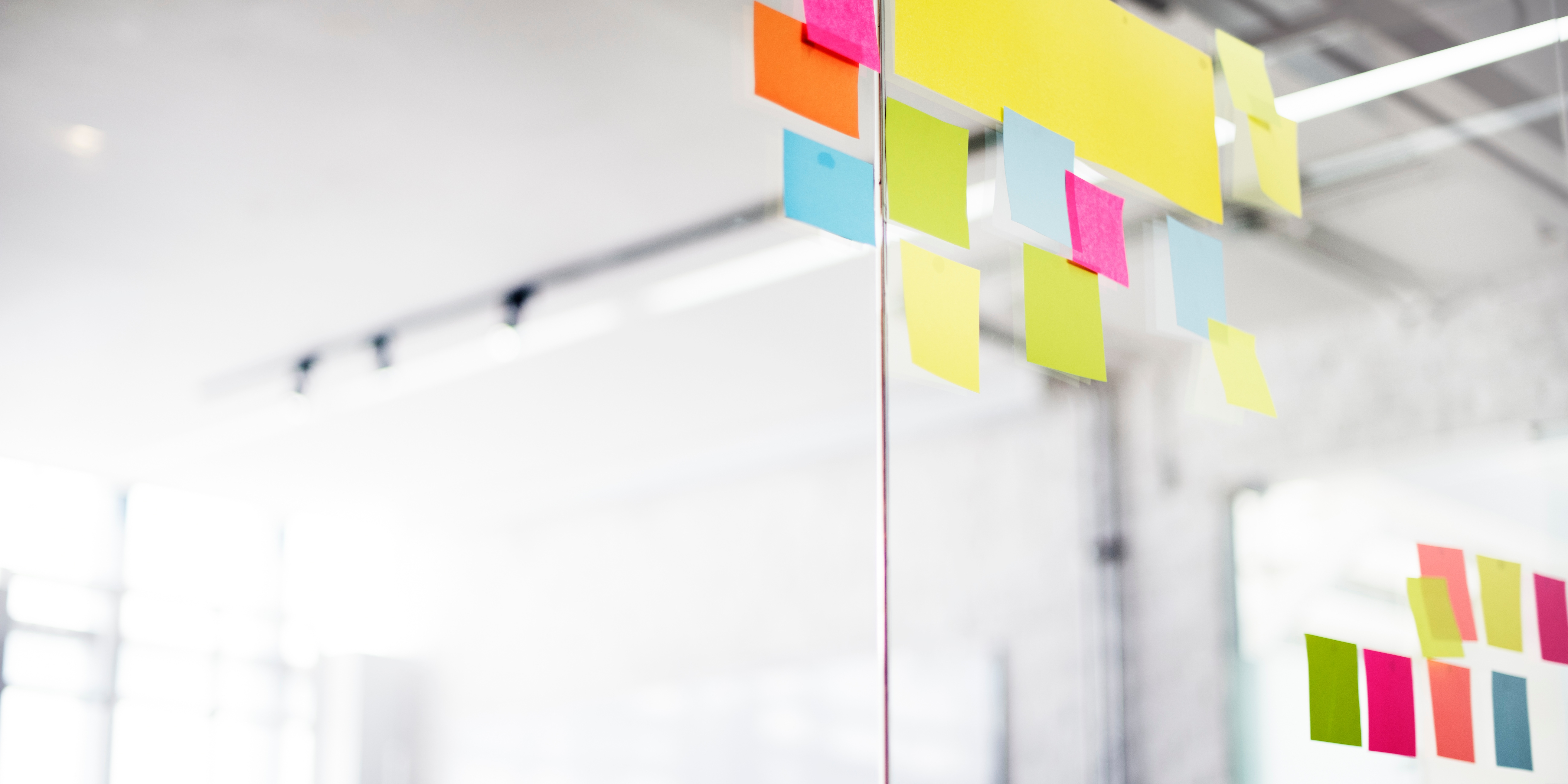 colorful-sticky-notes-on-glass