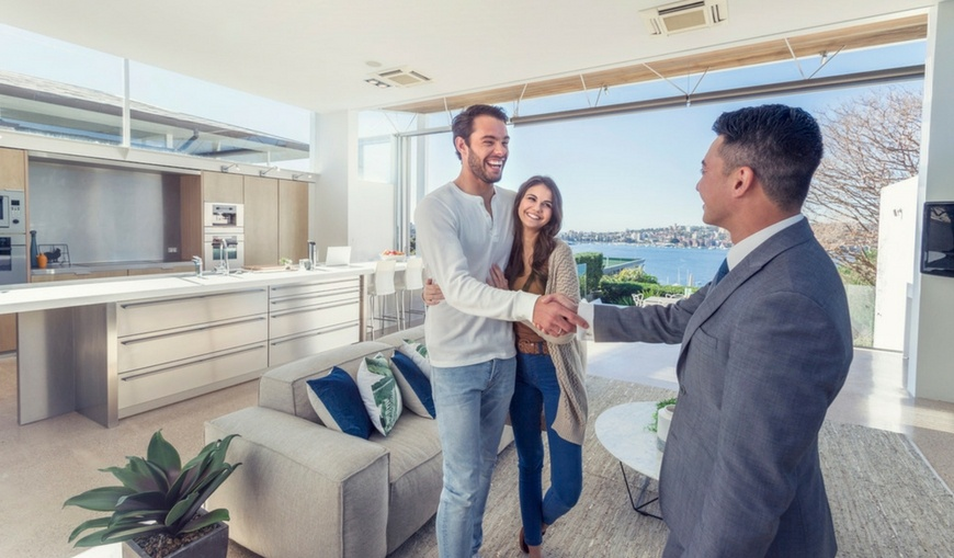 real-estate-handshake-smiles-happy-property-manager
