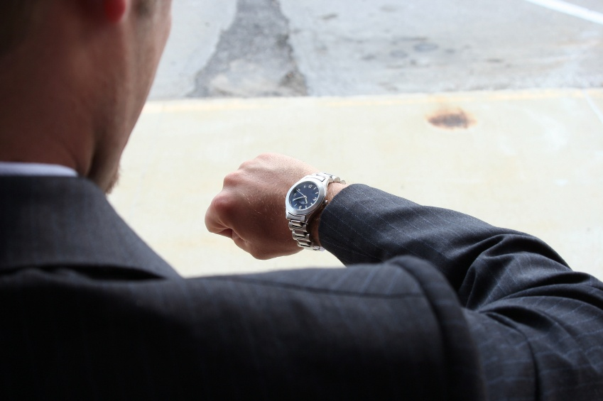 businessman-in-suit-looking-at-watch