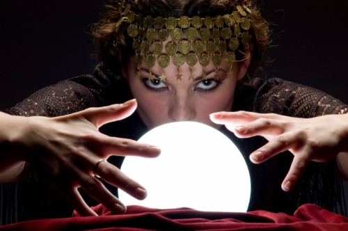 psychic-looks-into-glowing-crystal-ball