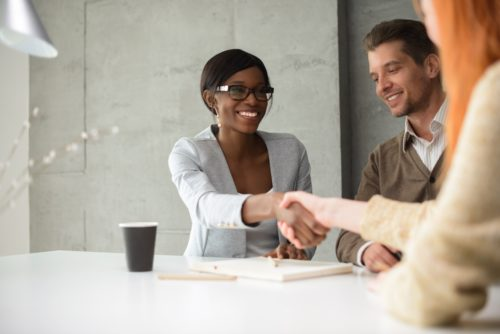 female-accountant-shakes-hands-with-clients
