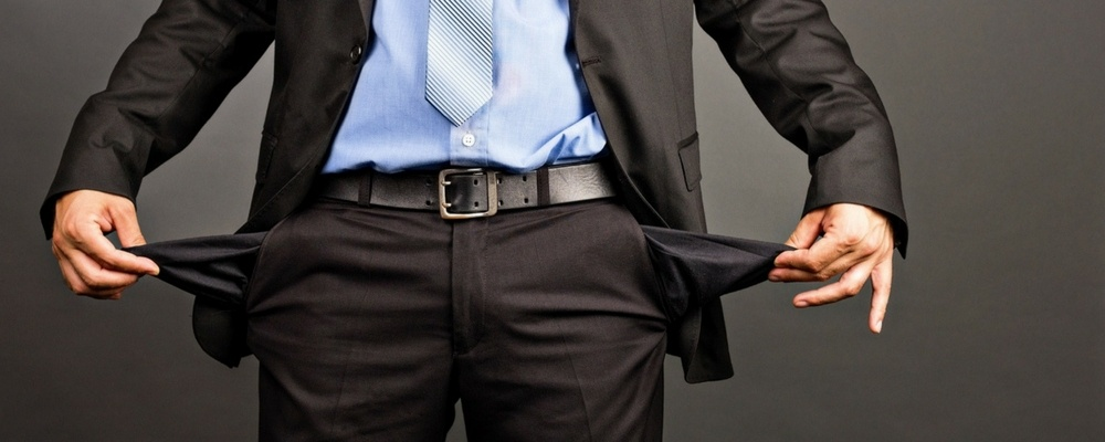 bankruptcy-law-guy-empty-pockets-suit.jpg