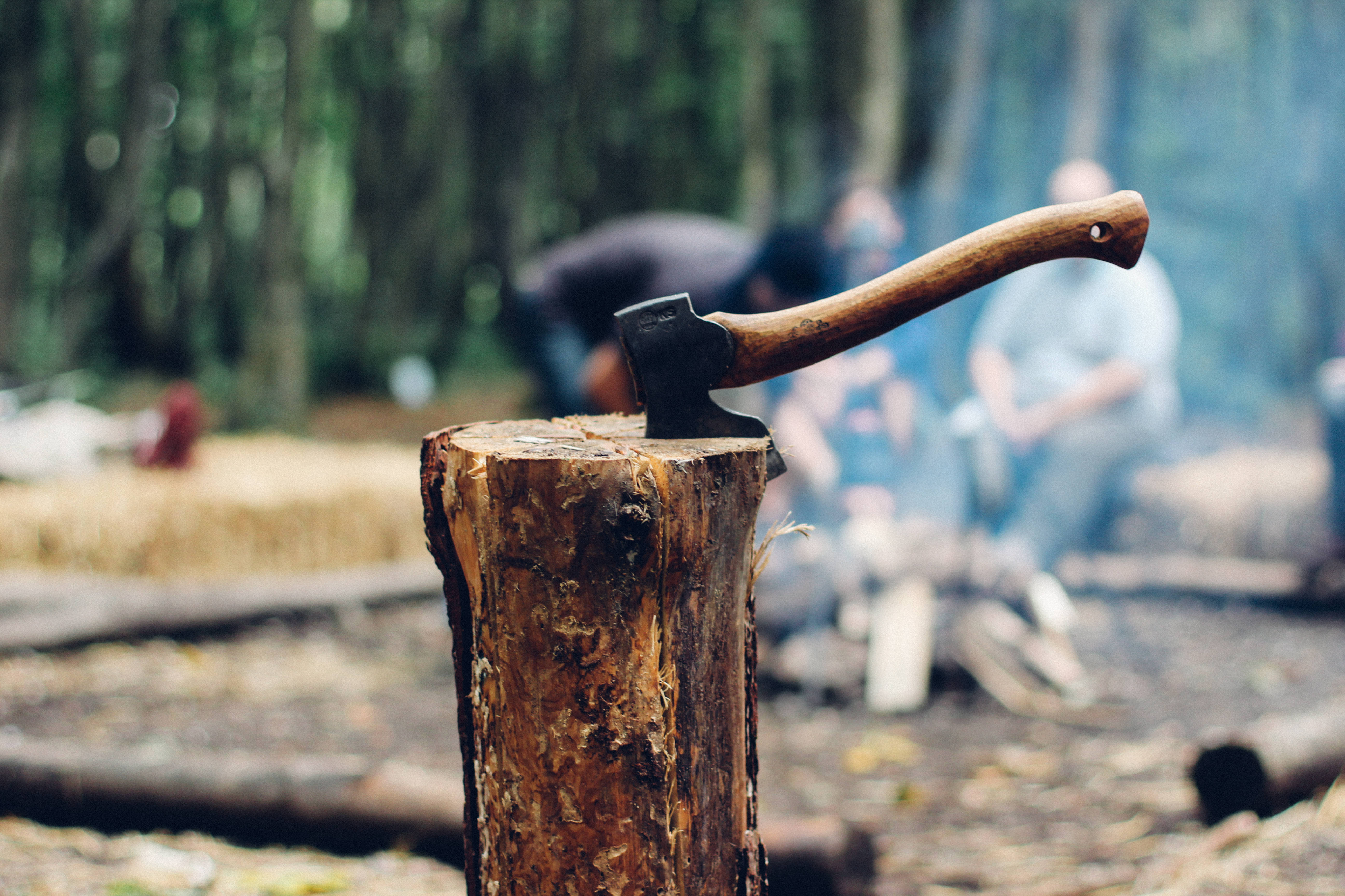 Axe-stuck-in-log-while-chopping-wood-camping