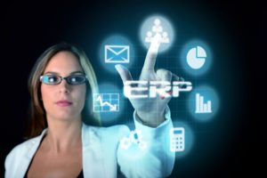 A woman wearing glasses and a white jacket selects an icon from a floating digital set of ERP icons