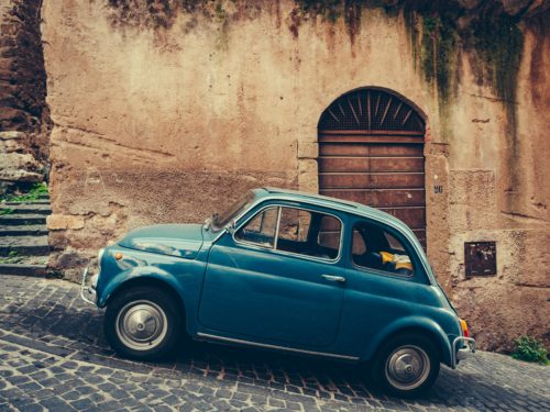 vintage-italian-car-on-cobblestone-road-niche-industry