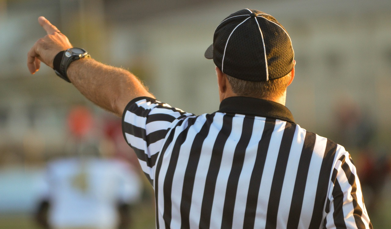 referee-making-a-call-about-grammar-rules