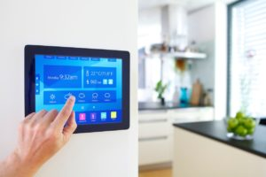 home-automation-device-with-kitchen-blurred-in-background