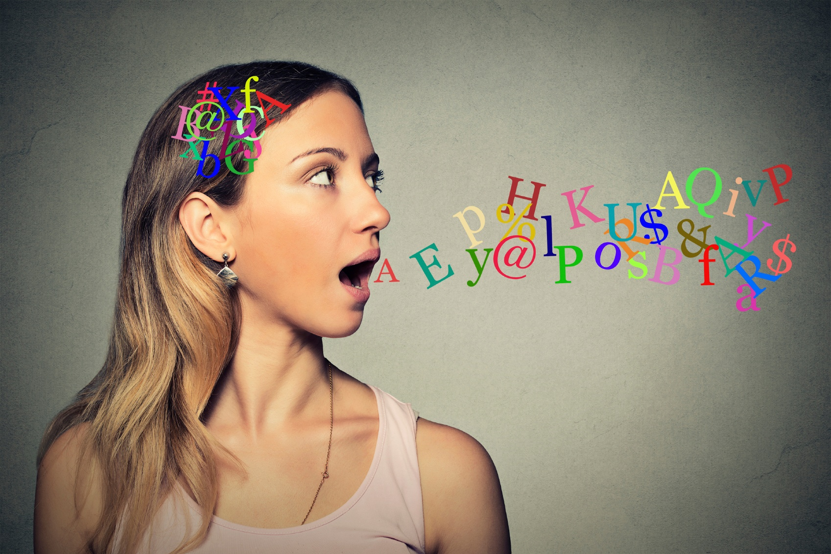 girl's-head-releasing-colorful-letters-as-she-speaks