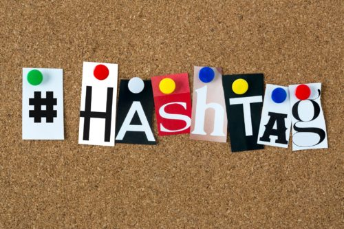 letters-from-magazine-spelling-hashtag-pinned-on-corkboard