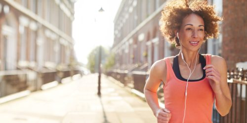 woman-jogging-in-city-on-sunny-day