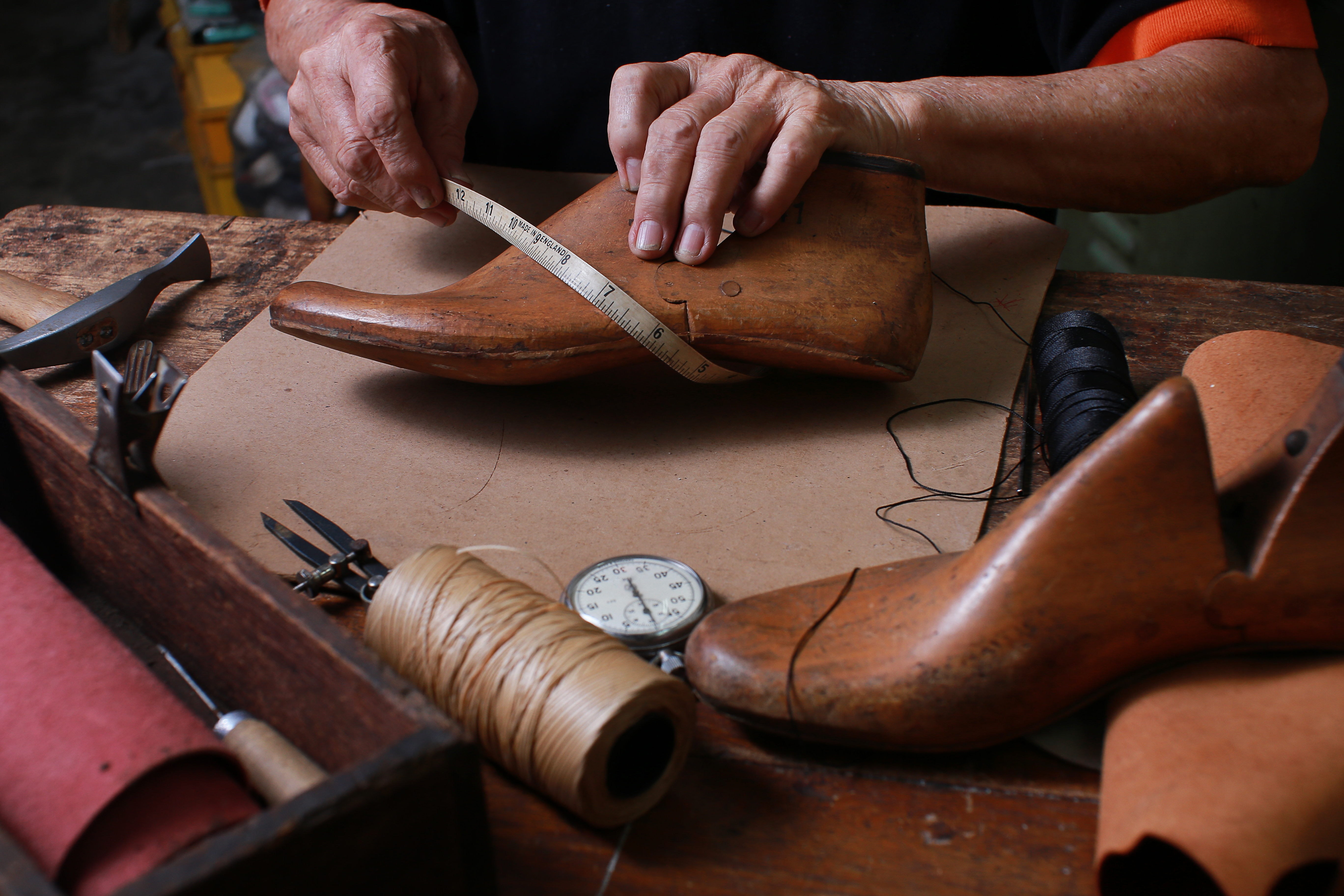 cobbler working on shoes