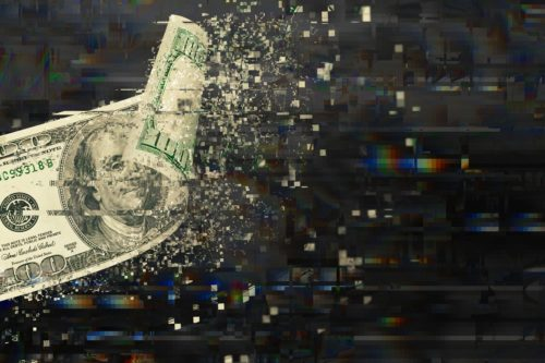 An edited image of a 100 dollar bill (US) disintegrating into a digital landscape