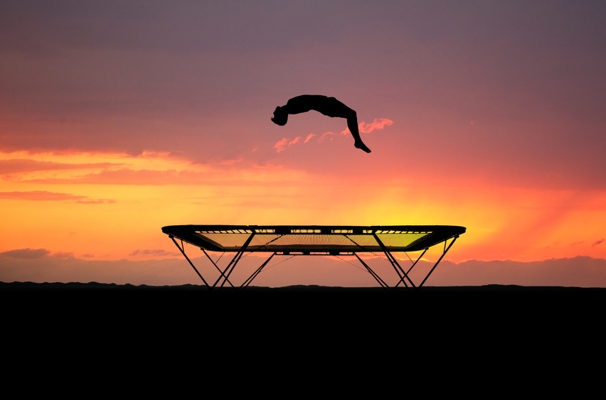 back-flip-on-trampoline-in-sunset