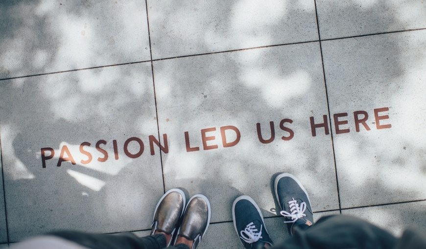 passion-led-us-here-on-concrete-with-feet.jpg