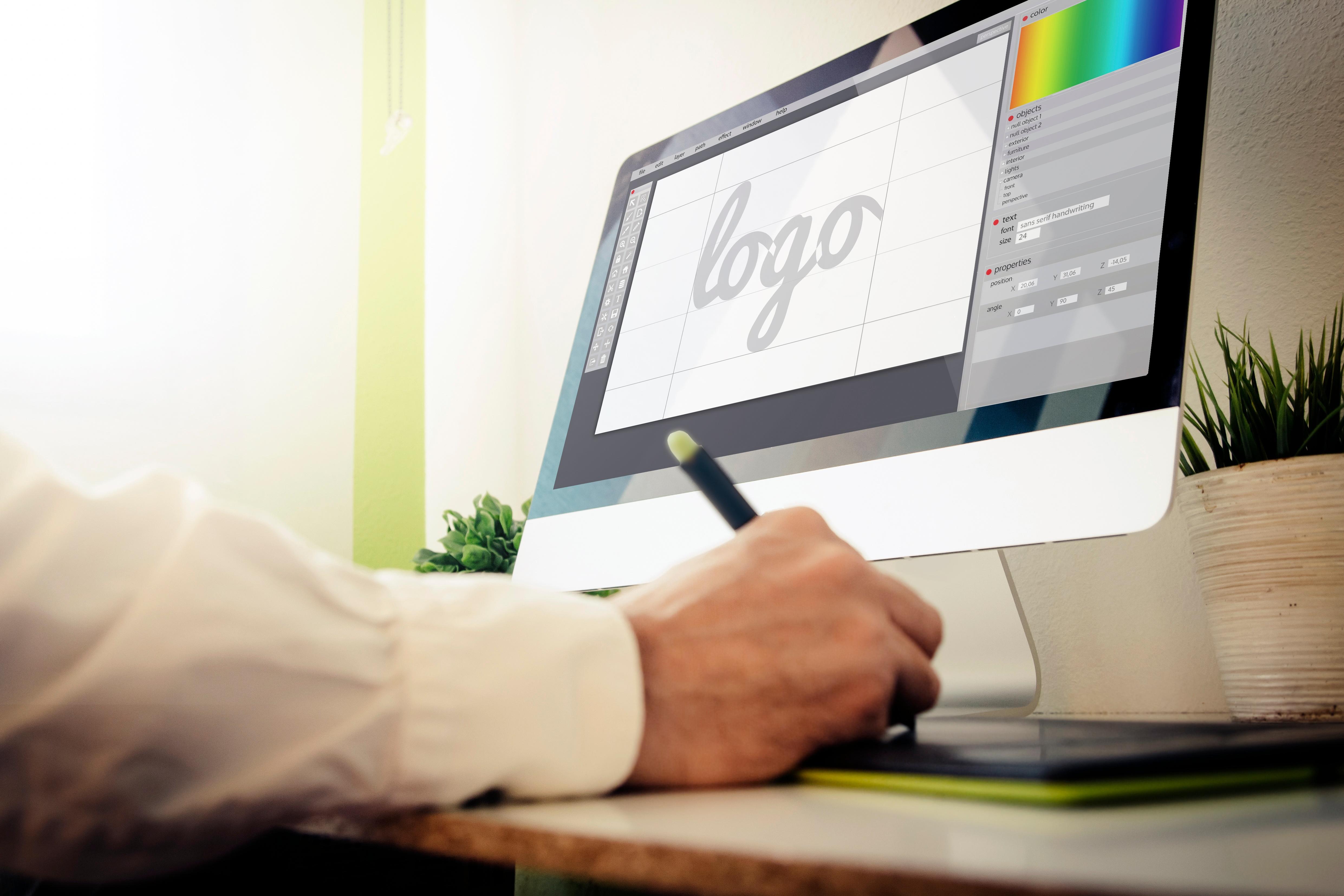 graphic designer works on logo for client