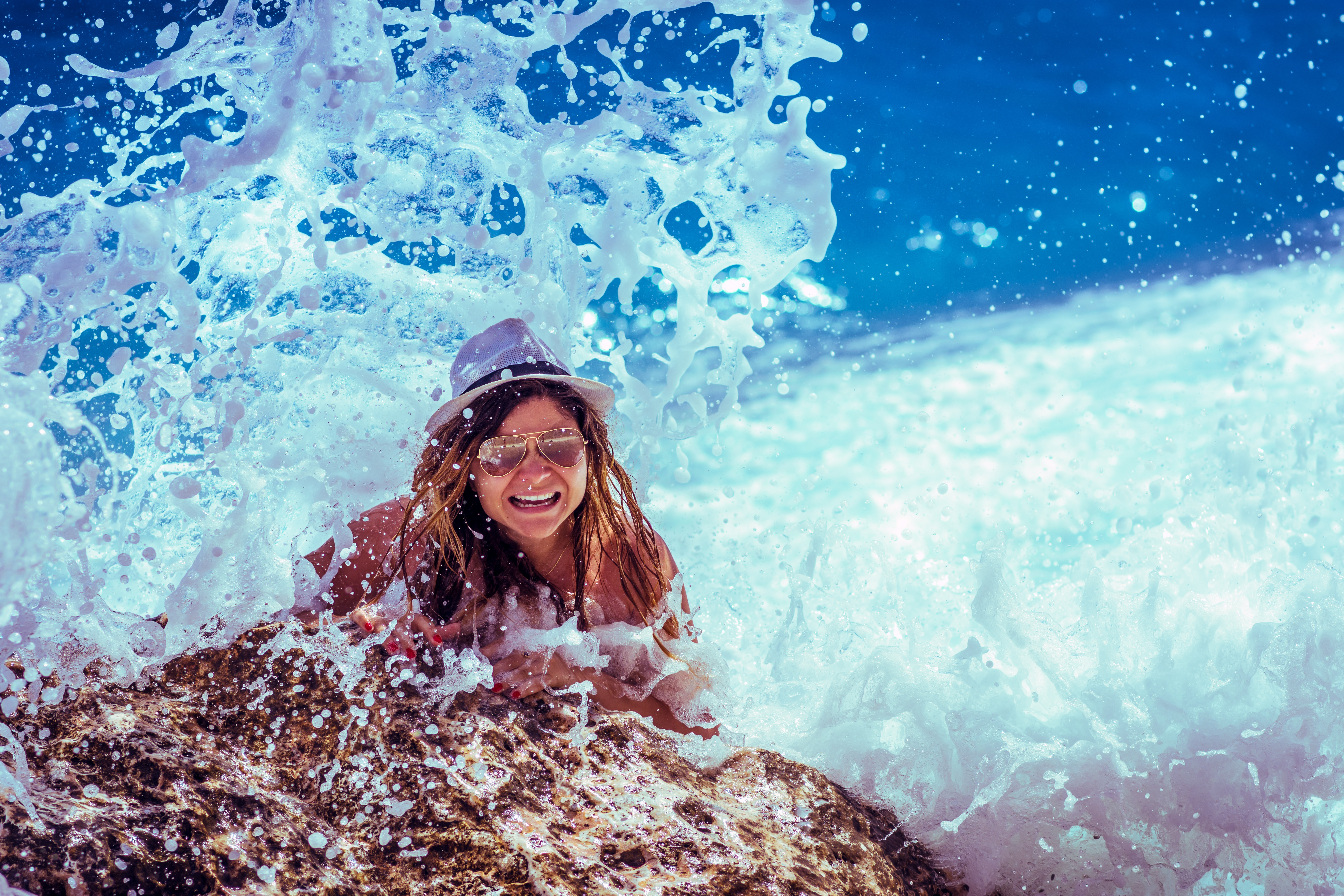 beachy-woman-getting-splashed-by-big-wave
