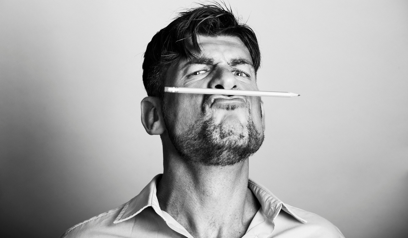 man-holding-pencil-angry.jpg