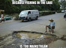 guy-fishing-in-giant-pothole-because-fishing-in-th-lake-is-too-mainstream