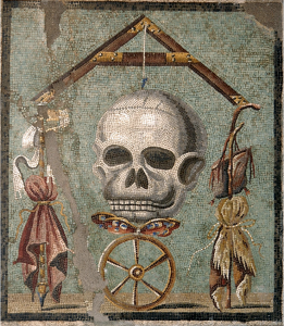 Mosaic from Pompeii, 30 BCE - 14 CE.  The skull is death, with a butterfly (the soul) and a wheel (fortune), below it.