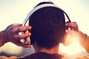 male-Gen-Z-listening-to-music-through-headphones