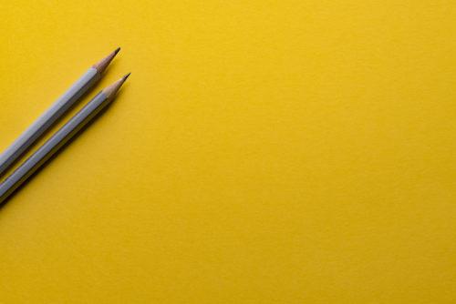 two-pencils-on-orange-background