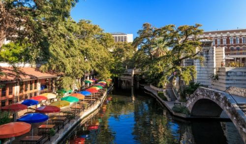 san-antonio-bridge-by-river-and-colorful-outdoor-umbrellas