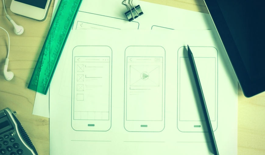 Sketches-of-email-graphics-and-smart-phones-on-desk