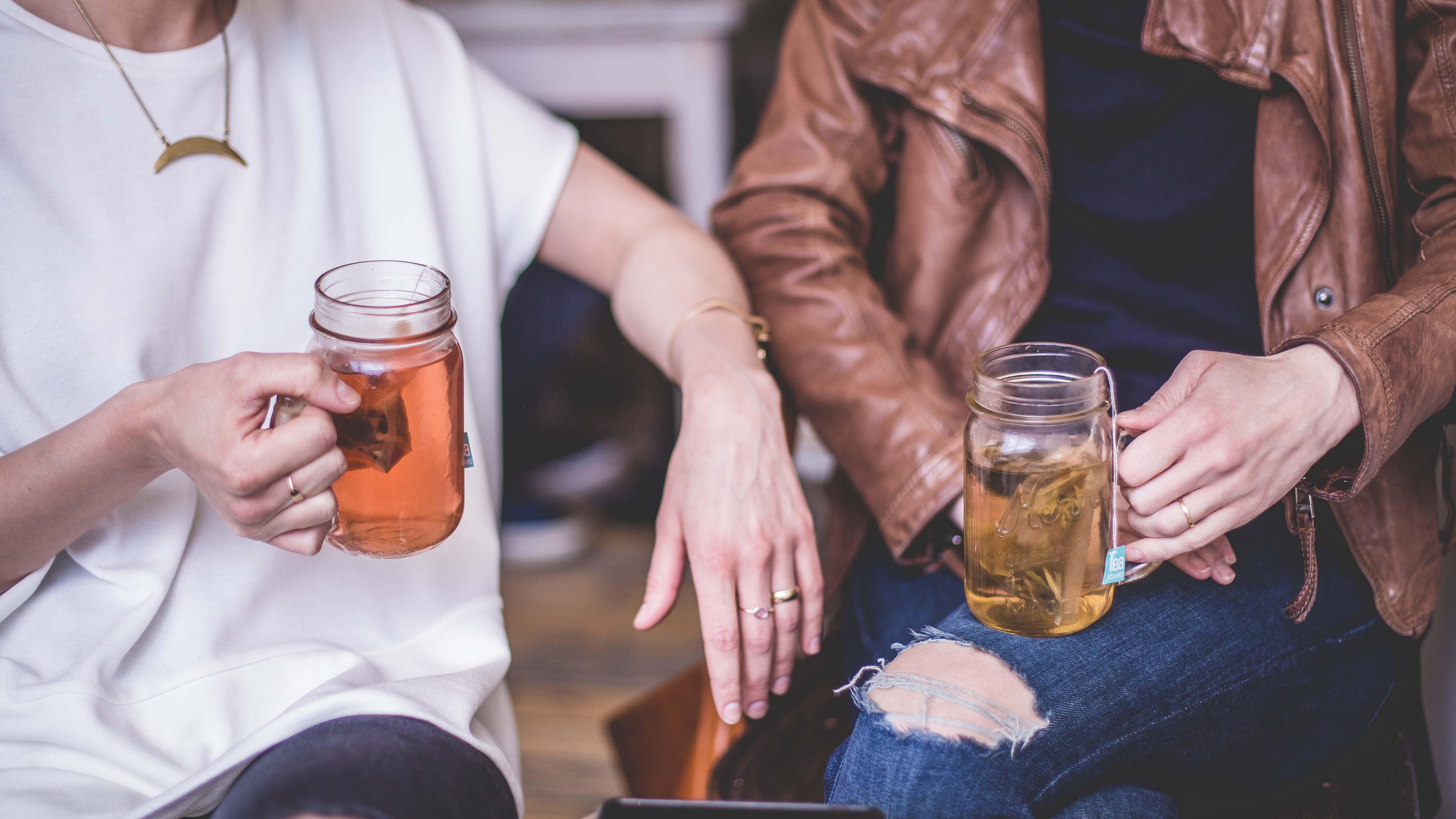 trendy-ladies-drinking-tea-from-mason-jars