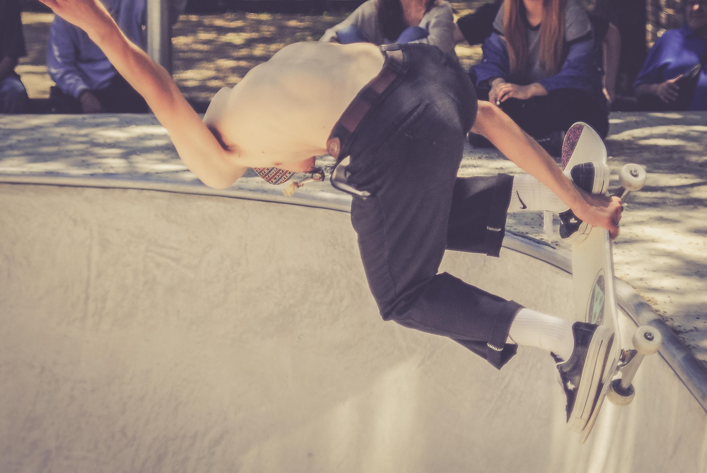 skateboarder-doing-tricks-in-skate-park