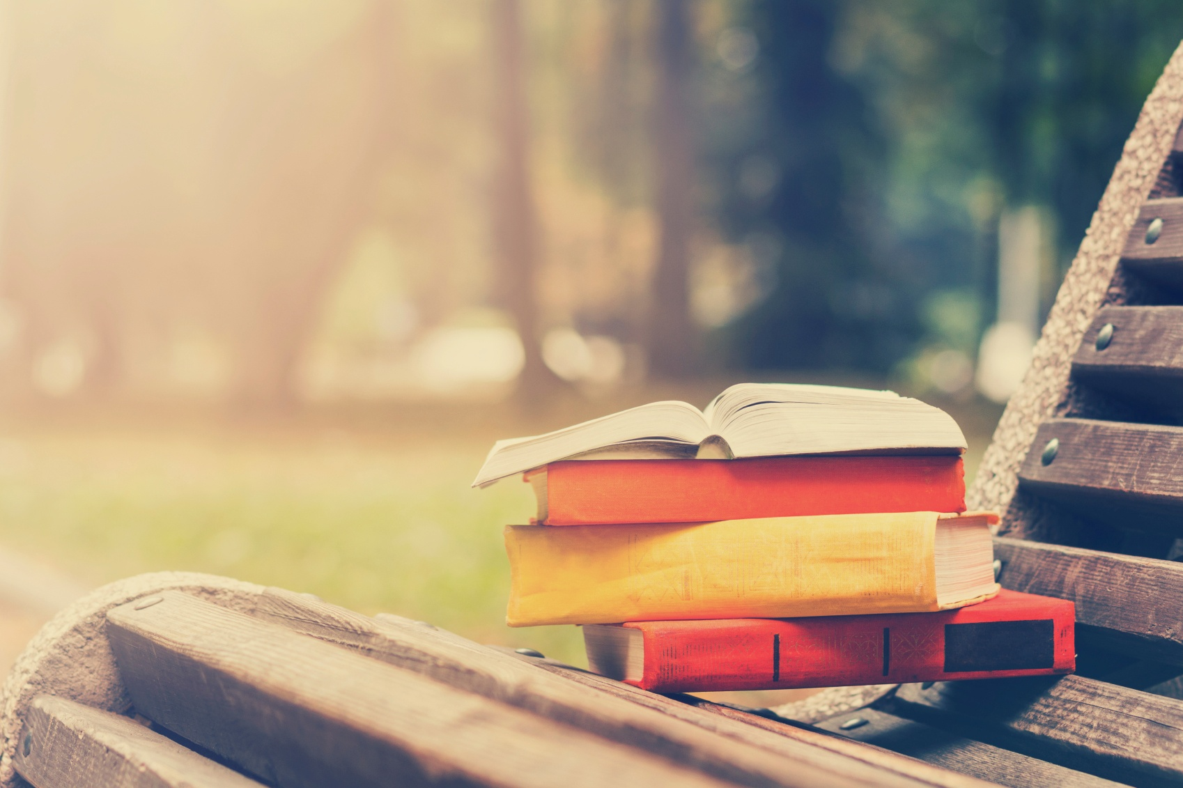 stack-of-books-on-wood-bench-full-time-job