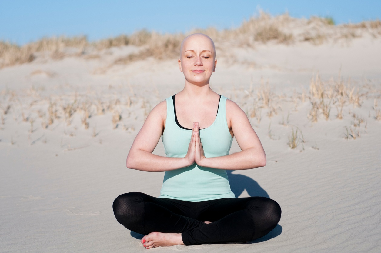 woman-cancer-survivor-meditate-yoga