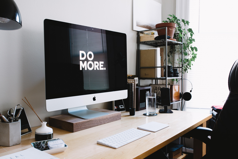 computer-sitting-on-desk-stating-do-more-in-blogging-trend