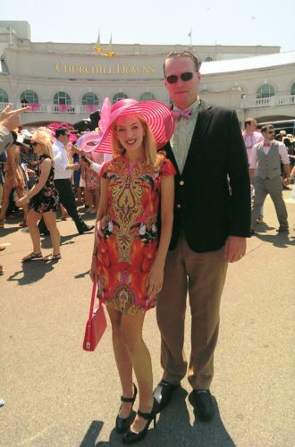 man and woman posing at the Kentucky Derby