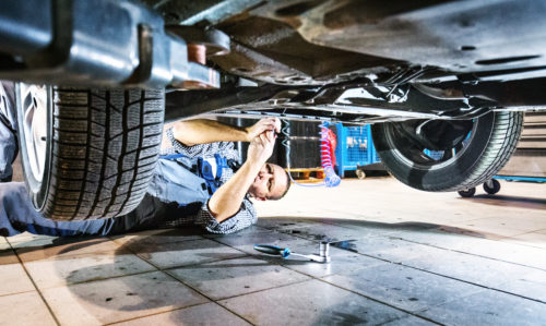 mechanic working on car maintenance