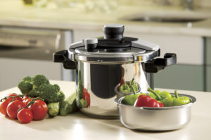 pressure cooker and vegetables sitting on a kitchen countertop