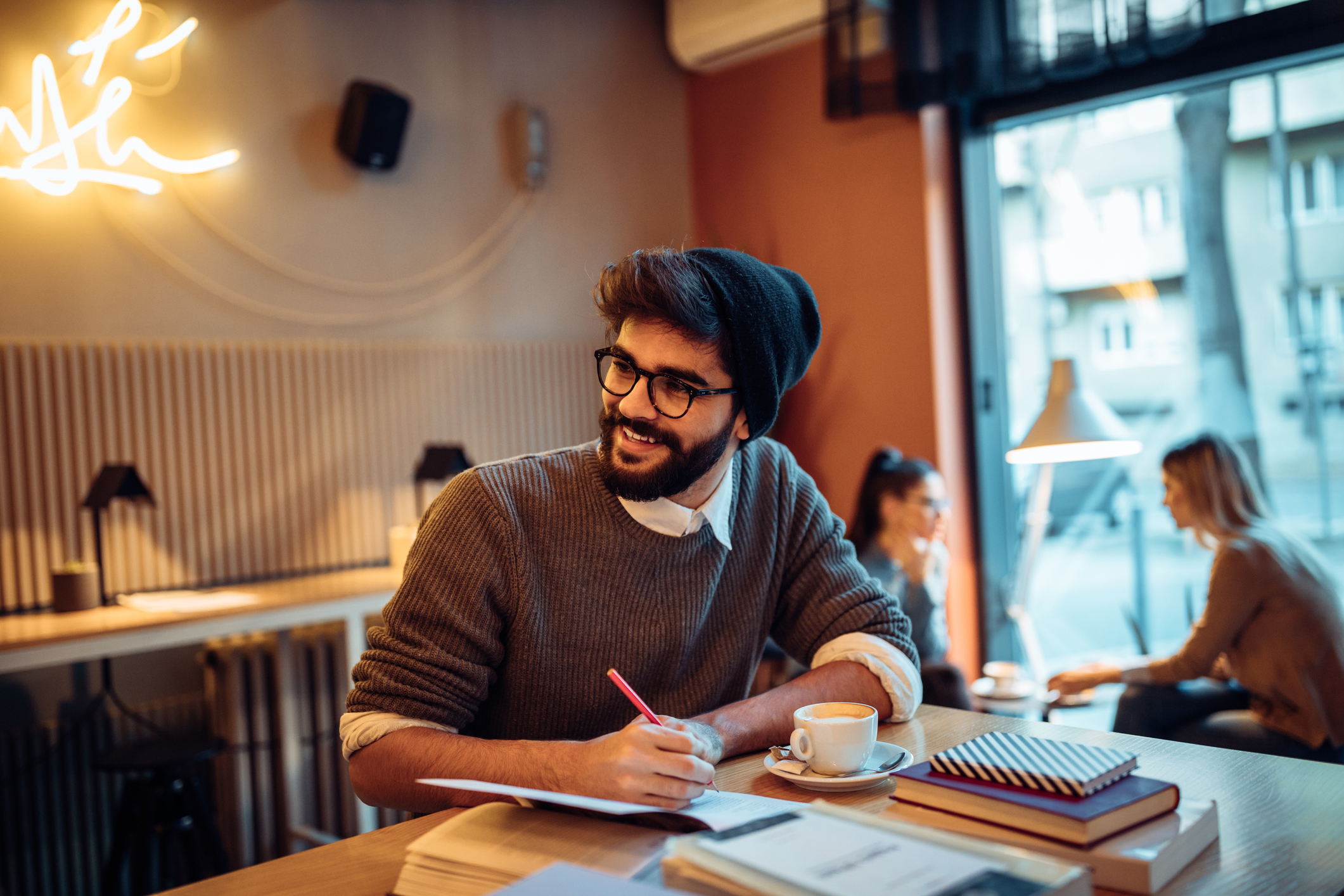 Young man studying in a coffee shop