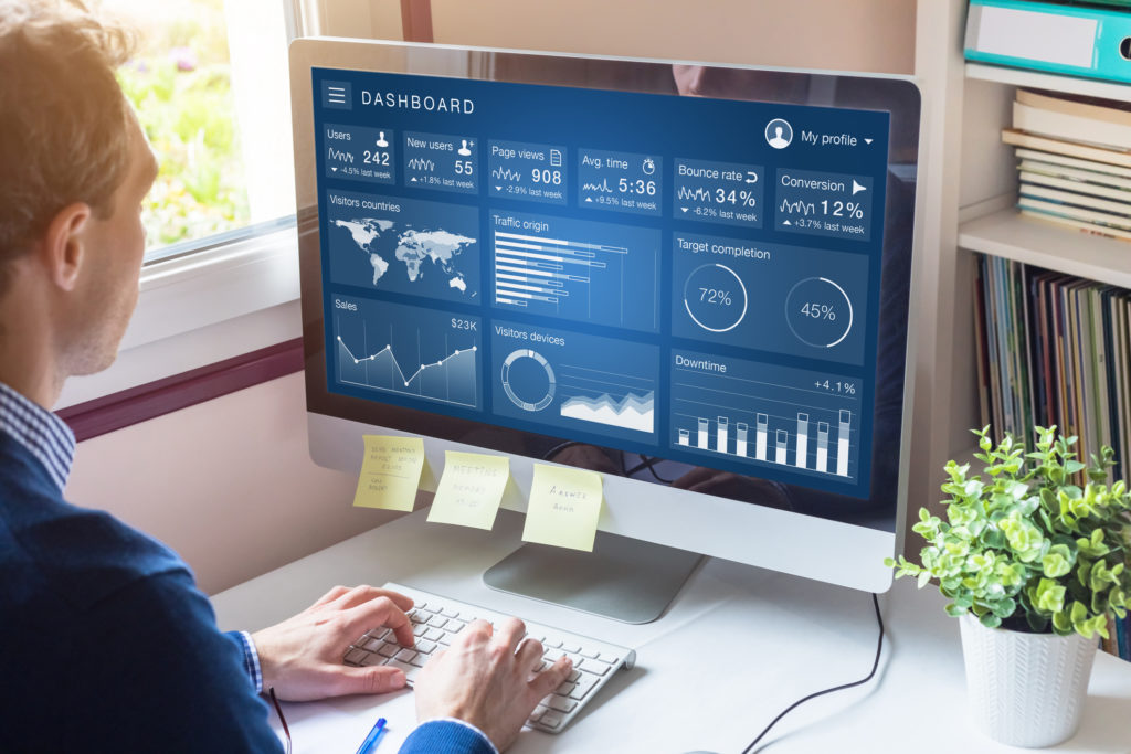 business person looking at digital marketing KPIs on computer screen