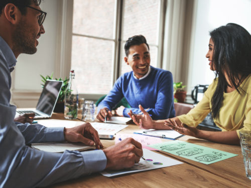 young employees planning retirement savings with financial advisor