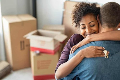 Hugging couple after moving into new home