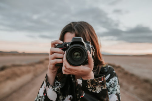 young photographer using a DSLR camera