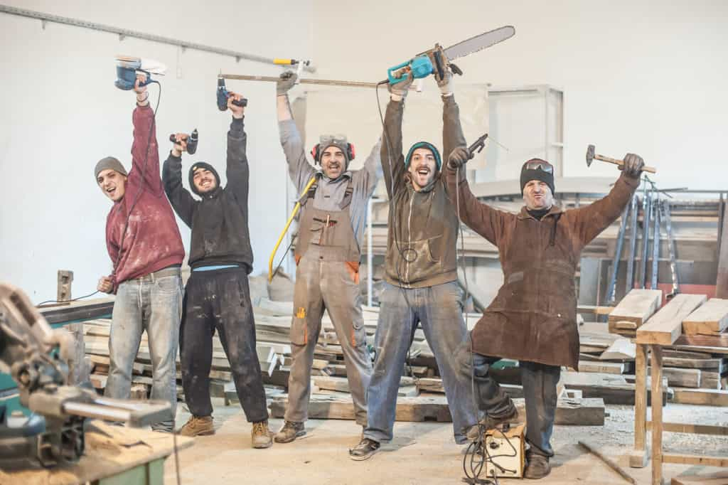 workers posing with tools