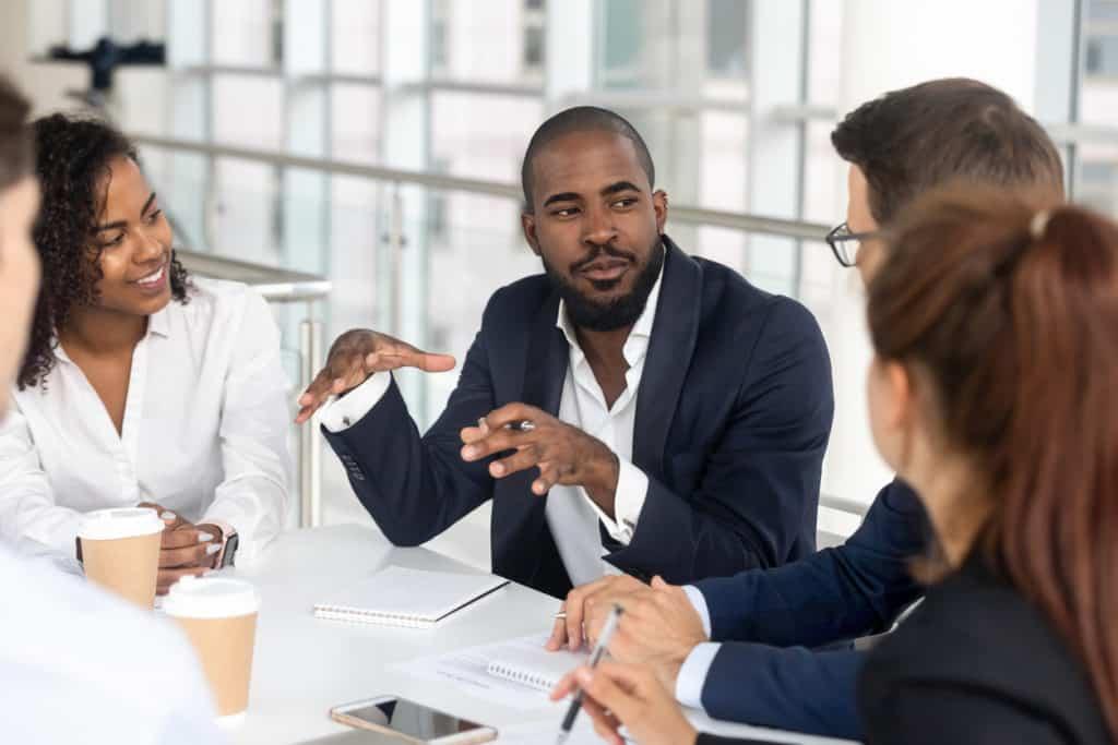 Millennial boss leading a team meeting