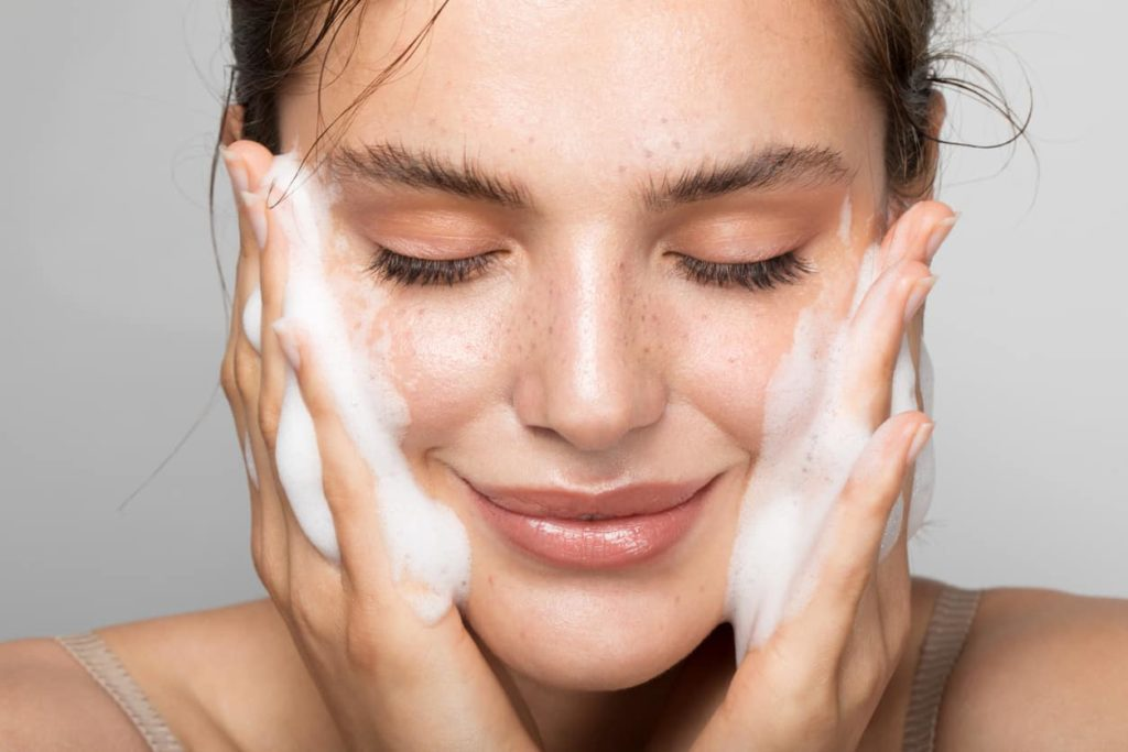 close-up of woman washing her face